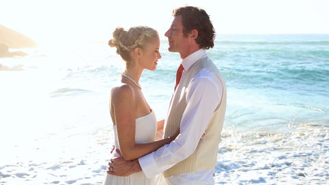 Newlyweds standing face to face on the beach Footage