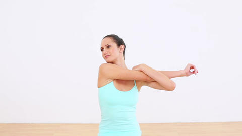 Fit model stretching her arms and smiling at camer Footage