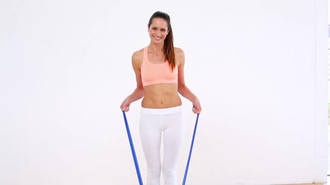 Fit model standing and stretching resistance band Footage