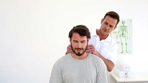 Physiotherapist Touching Patients Injured Neck stock footage