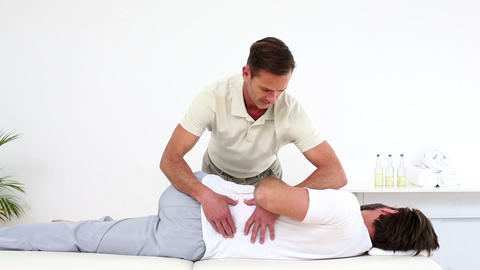 Physical therapist checking patients lower back Footage