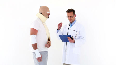 Doctor talking to very injured patient Footage