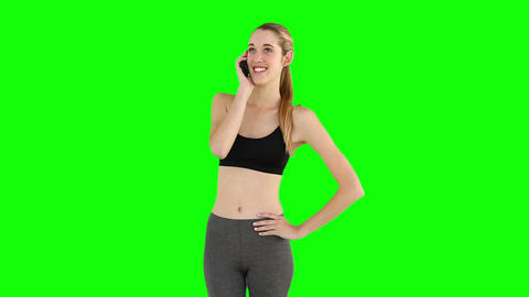 Fit model talking on the phone Footage