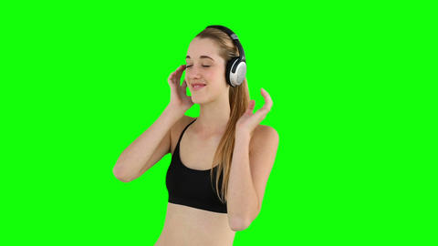 Fit model listening to music and smiling Footage