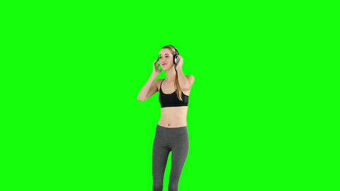 Fit model listening to music and dancing Footage