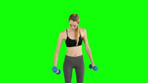 Fit model lifting dumbbells Footage