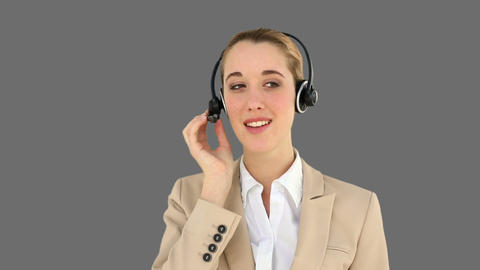 Smiling call centre agent talking on the headset Footage