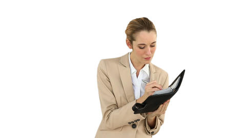 Businesswoman writing in her diary Footage