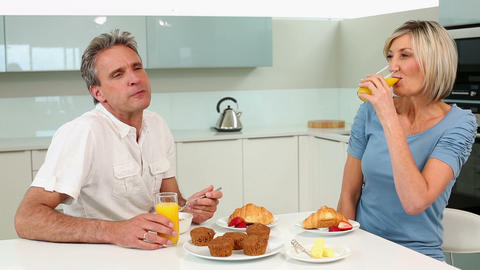 Mature couple enjoying a romantic breakfast togeth Footage