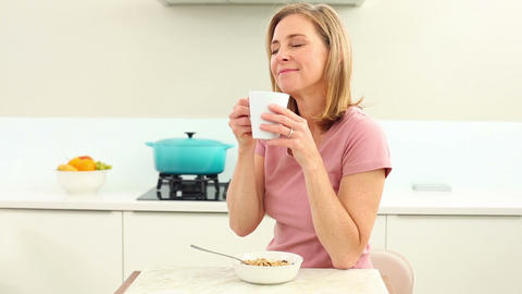 Mature Woman Having Coffee At Breakfast stock footage