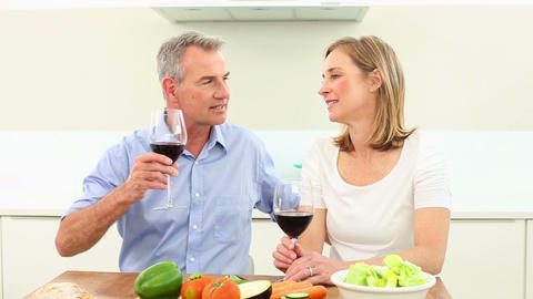 Mature couple drinking red wine together Footage