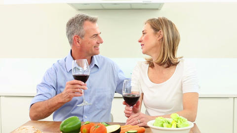 Mature couple drinking red wine together, Live Action