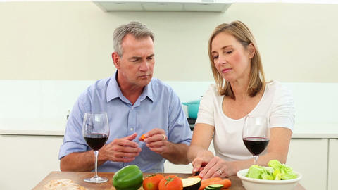 Mature couple drinking red wine together and makin Footage