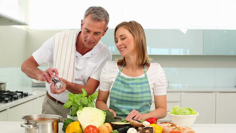 Mature couple making dinner together Footage
