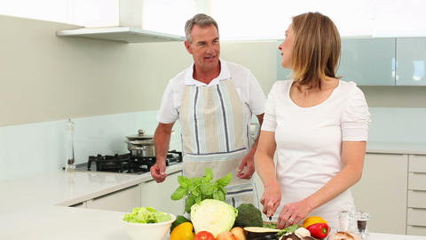 Mature happy couple making healthy dinner together Footage