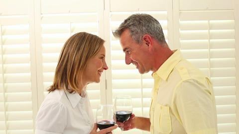 Romantic mature couple drinking red wine Footage