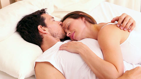 Affectionate couple sleeping on bed together Footage