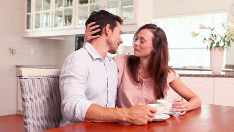 Happy couple drinking coffee together Footage