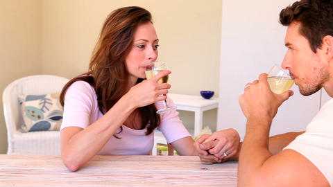 Happy couple drinking white wine together Footage
