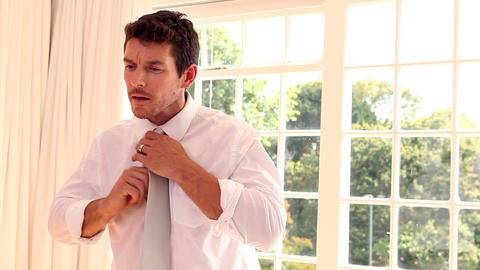 Businessman adjusting his tie Footage