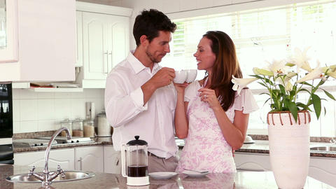 Happy couple having coffee in the morning Footage