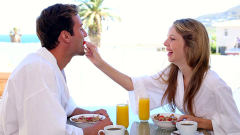 Happy couple having breakfast together Footage