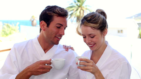 Happy couple having coffee together in bathrobes Footage