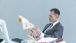 Businessman in office reading a newspaper and talk Footage