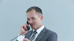 Businessman relaxing in office talking on phone Footage