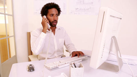 Businessman working at his desk Footage