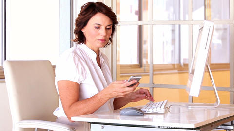 Businesswoman working at her desk Footage