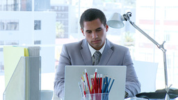 Businessman working in office and a colleague spea Footage