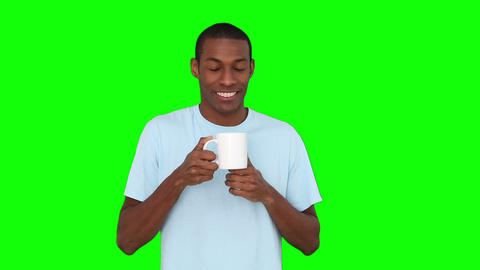 Casual Young Man Enjoying Cup Of Coffee stock footage