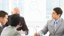 Businessmen talking in a meeting Footage