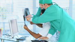 Medical team examining an xray Footage