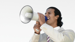Businessman shouting through a megaphone Footage