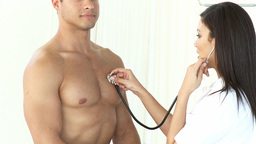 Doctor Measuring a patients Heart rate Footage