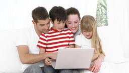 Happy Family at home browsing the net Footage