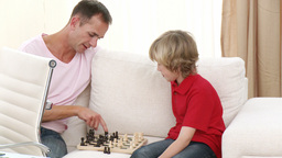 Father and son playing chess Footage