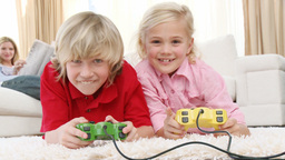 Children playing video games and parents on sofa Footage