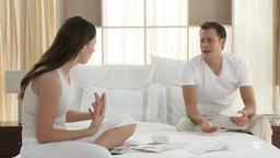 Couple arguing about bills in bedroom Footage