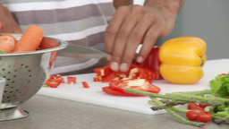 Close up of people preparing a salad in the kitche Footage