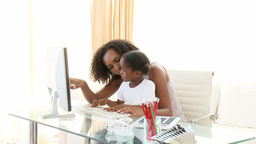 AfroAmerican mother and daugter using a computer Footage