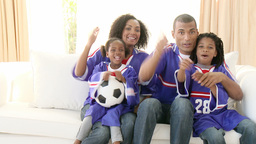 AfroAmerican family watching a football match at h Footage