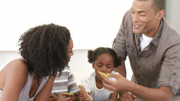 AfroAmerican parents and children eating confectio Footage