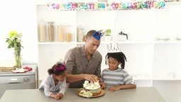 AfroAmerican dad and children celebrating a birthd Footage