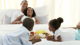 AfroAmerican family having breakfast in the bedroo Footage