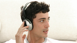 Male teenager listening to the music Footage