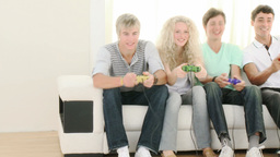 Teenagers Playing Video Games at home Footage