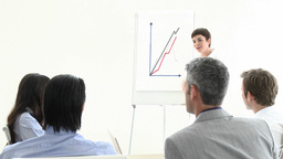 Positive business woman presenting a graph Footage